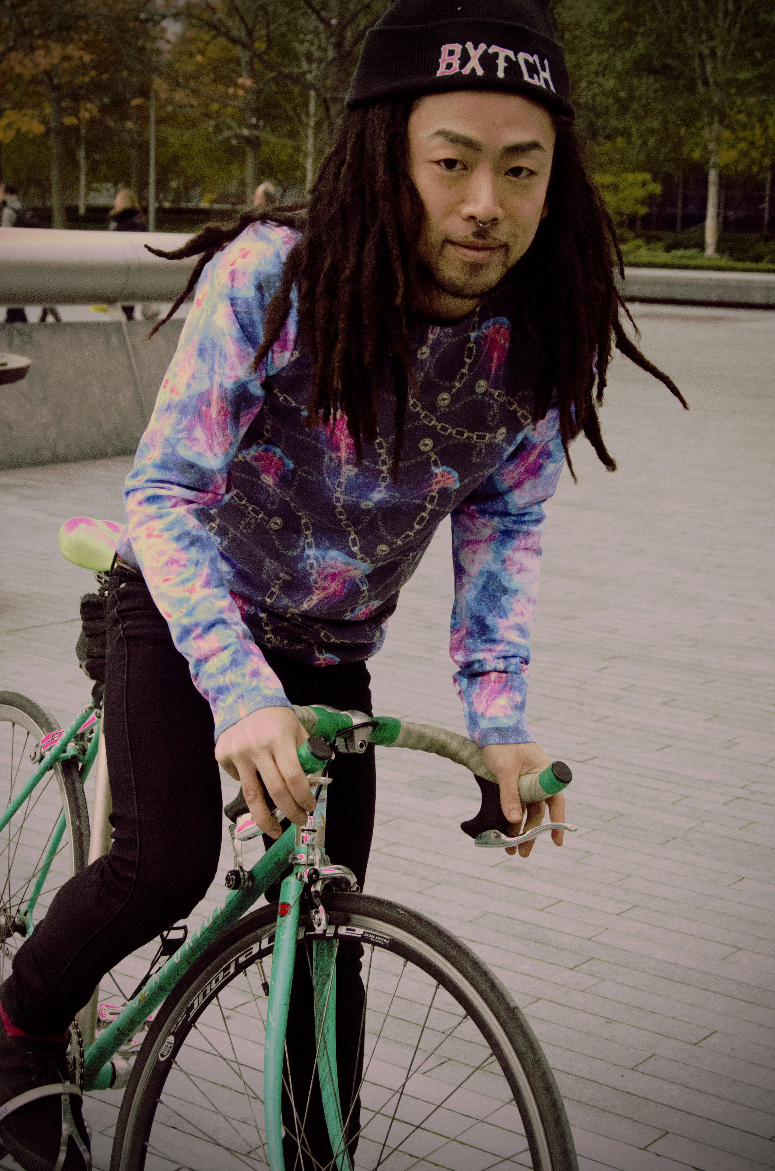 Marcy on a fixed gear green bike